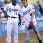 Actor Matthew McConaughey -- with his shirt on -- got chummy with second baseman Orlando Hudson after throwing out the first pitch two days later.