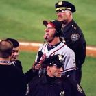 """After taunting Mets fans during the '99 NLCS, John Rocker added words to his gestures in SI, likening a trip to Shea to: """"riding through Beirut next to some kid with purple hair, next to some queer with AIDS, right next to some dude who just got out of jail for the fourth time, right next to some 20-year-old mom with four kids."""" Rocker's return to New York was marked with 700 police officers, a protective cover over the Braves' bullpen and a limit on beer sales."""