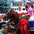 At the 117th Kentucky Derby, Chris Antley rides Strike the Gold to victory in 2:03.