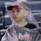 3-year-old Wade Rakestraw feels sad about the rain delay.