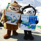 Miga and Quatchi are their names. We give them prop for being almost as awesome as Beijing's mascots.