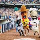 Wish we could have a Caption This contest for this photo, but first things first: why are there such things as Racing Sausages and why are they chasing down that poor catcher?