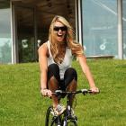 In a swimsuit or on a bike, Macpherson never fails to look hot.
