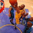 The Lakers prevailed in two overtime games and handled Orlando in five as Kobe Bryant won his first championship without Shaquille O'Neal and Phil Jackson won his record 10th title as a coach.