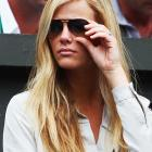 With Andy Roddick's wife, Brooklyn Decker, watching from the box, fans at Wimbledon wondered whether he really needed another trophy.