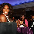 At least one person at Serena Williams' table is having a good time.