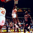 """Wilkins' nickname traces back to his college days at Georgia, although exploits of his high flying acrobats came even before that. Once Wilkins reached the NBA, he quickly became known for his spontaneous, show stopping dunks. That ability, coupled with his two slam dunk championships and regular scoring outbursts, solidified Wilkins' status as the """"Human Highlight Film."""""""