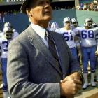 Once upon a time coaches actually dressed for work. Cowboys coach Tom Landry famously wore a suit before the NFL mandated (in 1993) that coaches wear team-issued clothing.