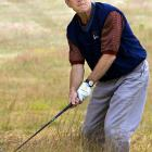 George W. Bush hits out of the rough as he finishes up a round at Cape Arundel Golf Club.