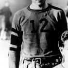 A young Richard Nixon dons his football attire while playing pigskin at Whittier High School, circa 1928.