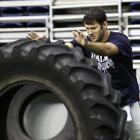 Romo didn't regret buying the monster truck until he had to deal with a flat tire.