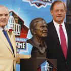 """ESPN personality Chris Berman (right) welcomed Wilson to the Hall of Fame, with a rousing, insightful """"circle the wagon"""" speech before the Canton faithful."""