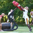 Alfred Fincher, a reserve linebacker who sees time on special teams, and Rocky McIntosh, starting weak-side linebacker, will add to the Redskins' promising defense.