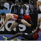 Nick Symmods, of the U.S. (not shown), took advantage of the tumble to win the heat in 1:45.96.
