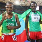 Kenenisa Bekele of Ethiopia celebrates winning the gold medal in the men's 10,000-meter final.