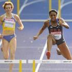 American runner Lashinda Demus (R) competes followed by Ukraine's Anastasiya Rabchenyuk in the first round of the women's hurdles.  Demus finished first in the fifth heat.