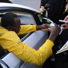 Bolt, seen here signing autographs, has one more race to run in Berlin, the sprint relay.