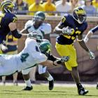 A week after leading the Wolverines to a thrilling victory over Notre Dame, Michigan quarterback Tate Forcier completed only 7 of 13 passes for 68 yards. But running back Carlos Brown ran for a career-high 187 yards, including a 90-yard TD, as Michigan ran its record to 3-0. Next up: Indiana.