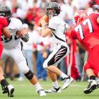 Tony Pike completed 18 of 26 passes for 300 yards and three touchdowns as the Bearcats improved to 4-0.