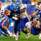 Tim Tebow had 123 yards rushing and two touchdowns, and added another 103 yards and a score through the air, until the third quarter.  The Gators were leading 31-7 and driving deep in Kentucky territory when Tebow was sacked by defensive end Taylor Wyndham and struck his head on teammate Marcus Gilbert's leg.  The crowd was silent until Tebow eventually sat up. In the fourth quarter, he was taken out of the stadium on a cart and was later taken to the hospital to have a CAT scan.