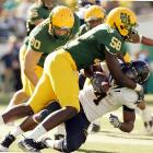 Josh Kaddu (56) and Lavasier Tuinei were part of an Oregon defense that held Jahvid Best to 55 yards rushing and Cal to a lone field goal. Best entered the game ranked third in the nation with an average of 137.33 yards on the ground.