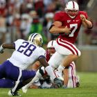 Toby Gerhart overpowered the Huskies with 27 carries for a career-high 200 yards and a touchdown and the Cardinal beat Washington 34-14.