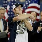 Andy Roddick embraces the championship trophy after defeating Juan Carlos Ferrero for his only Grand Slam victory.