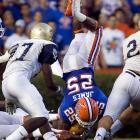Florida's Brandon James looks for a soft place to land after being upended on a punt return. He also caught a pass for 21 yards in the Gators' rout.