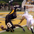 Tight end Leroy Banks landed painfully shy of the goal line after apparently being dropped from a plane over Hattiesburg as Southern Mississippi unveiled its groundbreaking air attack in a 26-19 triumph over clearly-startled Central Florida.