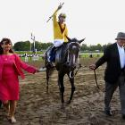 She earned $450,000 for Jackson's Stonestreet Stables and Harold McCormick, her owners, increasing her career total to more than $2.9 million. Jackson (right) and longtime friend McCormick bought the horse after she won the Oaks and decided to enter her in the Preakness two weeks later.