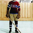 "Also known as ""The Mitchell Meteor"" after his birthplace (Mitchell, Ontario, Canada), the swift, supremely skilled center was playing for the Stratford (Ontario) Midgets when he caught the eye of the Canadiens, who signed him for the 1923-24 season. During his 14-year career, Morenz became the NHL's first superstar, winning two scoring titles, three MVP awards and three Stanley Cups while earning yet another nickname: The Babe Ruth of Hockey."