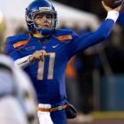 Kellen Moore threw for 285 yards and three touchdowns, including a pair to Austin Pettis, to lead Boise State to a victory over UC Davis.