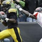 Marvin McNutt caught two touchdown passes and Iowa slipped past Arkansas State to give the Hawkeyes their best start since 1995.