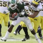 Larry Caper's overtime TD run gave Michigan State its first consecutive victories over Michigan since 1967.