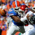 Florida's Carlos Dunlap (left) forces Arkansas' Dennis Johnson to fumble in the first half. After Alex Tejada yanked a 38-yard field goal with 3:08 remaining which would have given the Hogs the lead, Caleb Sturgis' 27-yard field goal with :09 left proved decisive.