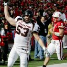 Texas Tech's Daniel Howard (left) celebrates as he gets past Nebraska quarterback Zac Lee to complete an 82-yard fumble return for a touchdown. The Red Raiders, who led 24-3 at the half, were held to to 259 yards -- 263 under their average -- but still posted their first win in four road games since last October.