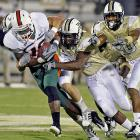 Miami tight end Dedrick Epps (left) proved hard to tackle. And the Hurricanes, behind Jacory Harris' 293 passing yards, proved hard to beat. The 'Canes (5-1) scored in each quarter to pull away from the Knights (3-3).