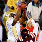 Georgia Tech completed only 1 of 7 passes, but Demaryius Thomas made his presence felt, outleaping Virgina Tech's Rashad Carmichael for a 51-yard completion. Quarterback Josh Nesbitt contributed far more with his legs, rushing for 122 yards and three touchdowns, as the Yellow Jackets handed the Hokies their second loss this season in Atlanta.