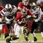 Alabama's Mark Ingram (22) shredded the South Carolina defense for 246 yards and a touchdown on 24 carries. The Crimson Tide led 13-6 after three quarters before Ingram's 4-yard scoring run put the game away.