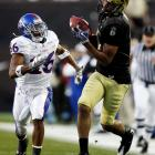 Colorado wide receiver Markques Simas (right) hauls in a pass for a 36-yard gain. Colorado scored 24 second-quarter points to help offset Todd Reesing's 404 passing yards and further muddle the Big 12 North standings.