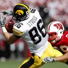 Trey Stross holds onto a Ricky Stanzi pass despite the best efforts of UW's Niles Brinkley. Iowa, which trailed at halftime, became just the second Big Ten team to win at Wisconsin and at Penn State in the same season (Michigan has done it twice).