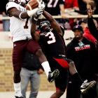 Texas A&M's Uzoma Nwachukwu outjumps Texas Tech's Jamar Wall for the ball in the second quarter of their Big 12 shootout. Nwachukwu caught four balls for 79 yards and Cyrus Gray rushed for 132 yards and three scores as A&M snapped a three-game losing streak by winning in Lubbock for the first time since 1993.