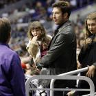 There is apparently something amiss with the bloke in the purple jacket at the Kings-Coyotes game at the Staples Center in L.A.