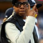 Cleverly disguised as a Spike Lee-DMC hybrid, the hip-hop icon watches Game 1 of the ALDS at Yankee Stadium.