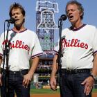 Kevin (left) and older brother Michael cooked up a sizzling Star-Spangled Banner before Game 1 of the NLDS between Philadelphia and Colorado.