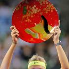 The tennis star happily holds the distinctive pan that gives the Pan Pacific Open tournament its name.