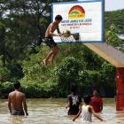 These plucky kids made the best of the worst flooding in the Philippines in 40 years.