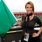 The reality star poses with a real green flag before the start of NASCAR's Pepsi 500 at Auto Club Speedway in Fontana, CA.
