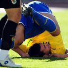 The Brazilian midfielder grabs an impromptu siesta during a FIFA World Cup qualifying match with Bolivia in La Paz on Oct. 11.
