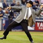 Anyone who would accuse the Yankees of having a corporate image need look no further than the natty Mr. October as he chucks the first pitch at Game 2 of the ALDS on Oct. 9.